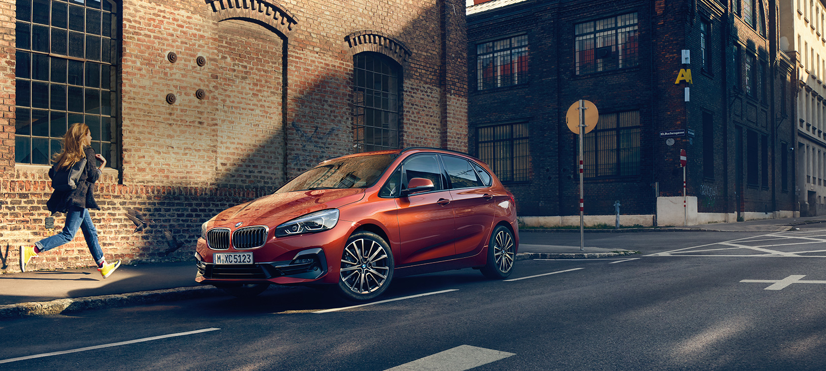 BMW 2 Series Active Tourer F45 Facelift 2018 Sunset Orange metallic three-quarter front view parking on the road